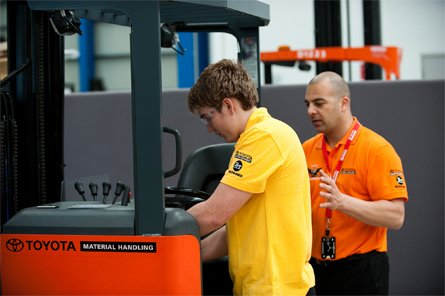 Man servicing a forklift truck